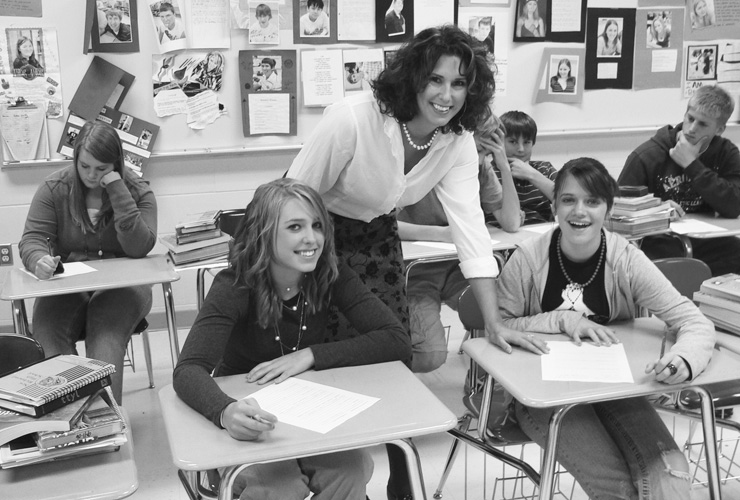 Wisconsin English teacher Deena Neumann with students in her 9th grade classroom